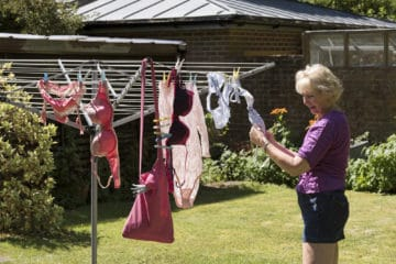 woman drying clothes outside